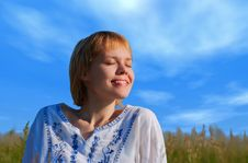 Beauty Girl In Field Under Clouds Stock Photography