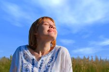Beauty Girl In Field Under Clouds Royalty Free Stock Photo