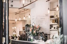 Free Inside The Restaurant With Pendant Lamps And Flowers Royalty Free Stock Images - 106006199
