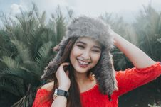 Free Woman In Red Off Shoulder Top Wearing Fur Beanie Smiling For Photo Royalty Free Stock Photography - 106006217