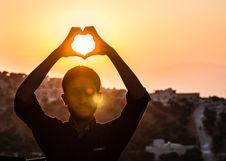 Free Person Making Heart Shape With His Hand During Sunset Royalty Free Stock Image - 106006246