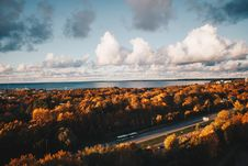 Free Aerial Photo Of Car On The Road Surrounded By Brown Trees Under Alto Cumulus Clouds And Clear Blue Sky Stock Photo - 106058640