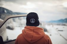 Free Person Wearing Black Cap And Orange Hoodie Turning His Back Royalty Free Stock Image - 106058686