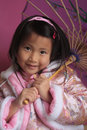 Free Little Chinese Girl With Unbrella Royalty Free Stock Image - 10618346