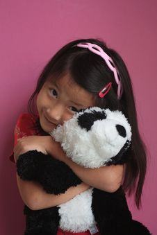 Free Little Chinese Girl With Panda Bear Royalty Free Stock Image - 10618336