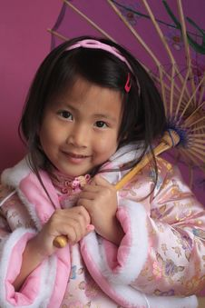 Little Chinese Girl With Unbrella Royalty Free Stock Image