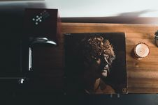 Free Top View Photography Of Vinyl Album Case Near White Tealight Candle Placed On Brown Table Stock Photos - 106122973