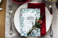 Free Merry Christmas Card On Plate Between Fork And Knife Stock Photography - 106173912
