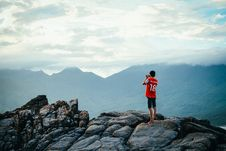 Free Man Having A Picture On Rock Stock Photography - 106174072