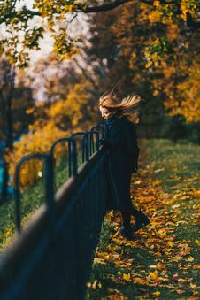 Free Woman Wearing Black Coat Near Railings Royalty Free Stock Images - 106240289