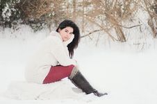 Free Woman In White Sweater Sitting Near Grass During Winter Season Stock Images - 106240324