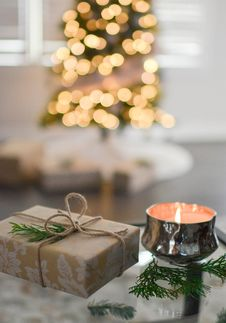 Free Close-Up Photography Of Gift Besides Candle Stock Photos - 106240333