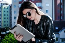 Beauty Girl Reading News On The Tablet On A Beautiful Spring Day Outside Royalty Free Stock Image
