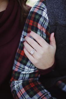 Free Woman Wearing Silver-colored Solitaire Ring Holding Person S Arm Royalty Free Stock Photography - 106306317