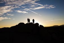 Free Silhouette Photo Of People On Top Of Rock Formation Royalty Free Stock Photos - 106306398