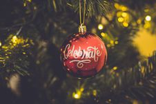 Free Red Celebrate Print Baubles Hang On Green Christmas Tree Stock Image - 106306511