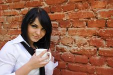 Girl With A Cup Of A Drink Stock Photos