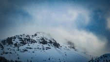 Free Snow Covered Mountain Under Cloudy Blue Sky Stock Image - 106424221