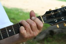 Free Aged Hand Playing Guitar Royalty Free Stock Photo - 1077785