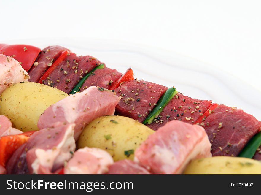 Turkish beef, lamb, and pork kebabs with potato on skewers