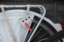 Free Playing Card On A White Wheel Of Fortune Bike Stock Photo - 10729450
