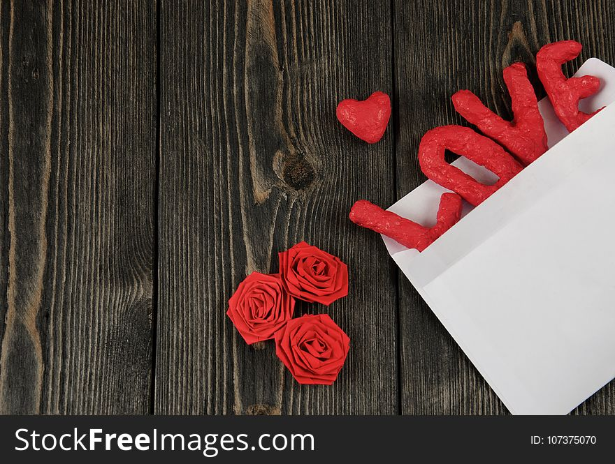 Word LOVE on wooden background. Concept of Valentine`s Day.