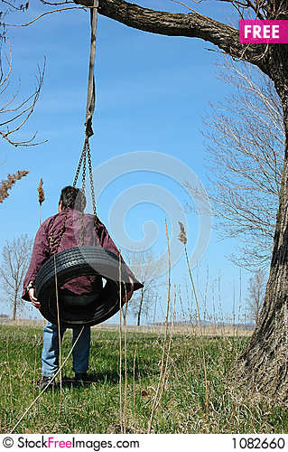 Free Man On Swing Tire 2 Stock Photo - 1082660