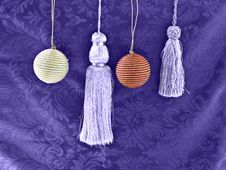 Free Christmas Ornaments On Purple Stock Image - 10871151