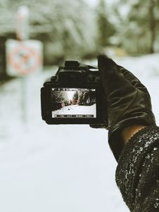 Free Close-up Photo Of Person Holding Black Camera Royalty Free Stock Image - 108798536