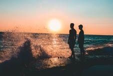 Free Two Men Standing On Seashore Royalty Free Stock Photo - 108798815