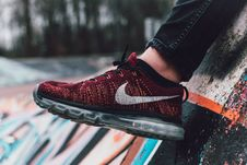 Free Close-Up Photography Of Red And Black Nike Running Shoe Royalty Free Stock Photography - 108798827