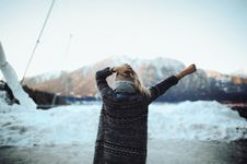 Free Woman In Gray And Black Tribal Cardigan Standing In Front Of Snow Fields Stock Photography - 108798852