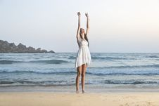 Free Photo Of Woman In White Sleeveless Dress Raising Hands Royalty Free Stock Image - 108798956