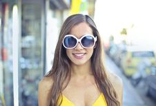 Free Woman Wearing Yellow Spaghetti Strap Top And Round Sunglasses Royalty Free Stock Images - 108798979