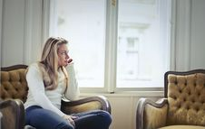 Free Photography Of Woman Sitting On Chair Near Window Royalty Free Stock Photo - 108799065