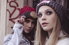 Free Two Women In Beanie Caps Taking Selfie Stock Photo - 108799250