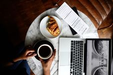 Free Macbook Pro And A Cup Of Coffee On Table Stock Photo - 108847560