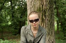 Free Beautiful Girl Sitting On A Park Royalty Free Stock Photos - 1091498