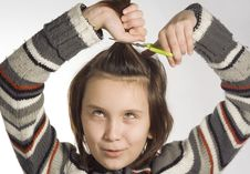 Cutting Hairs Royalty Free Stock Photography