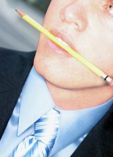 Free Business Man Biting Pencil Stock Photos - 1099063