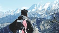 Free Photography Of Man In Black Hooded Jacket And Red Backpack Facing Snow Covered Mountain Royalty Free Stock Photos - 109219888