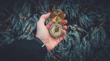 Free Person Holding Compass Stock Photography - 109219902