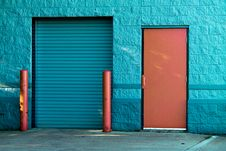 Free Brown Panel Door Near Roll-up Gate Royalty Free Stock Images - 109219909