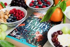Free Grimms Fairy Tales Book Surrounded By Fruits Royalty Free Stock Photo - 109293005