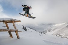 Free Man In Black Snowboard With Binding Performs A Jump Stock Photo - 109293010