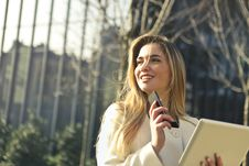 Free Woman Wearing White Top Holding Smartphone And Tablet Stock Photo - 109635430