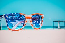 Free Focus Photography Of American Flag-accent Wayfarer-styled Sunglasses With Sea Background Royalty Free Stock Images - 109708409