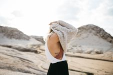 Free Women Taking Off Knitted Sweater Royalty Free Stock Photography - 109885457