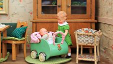 Free Brown Haired Girl Doll Holding Baby In Bassinet Doll Royalty Free Stock Photo - 109885505