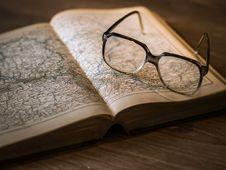 Free Black Framed Eyeglasses On Book Royalty Free Stock Images - 109885549